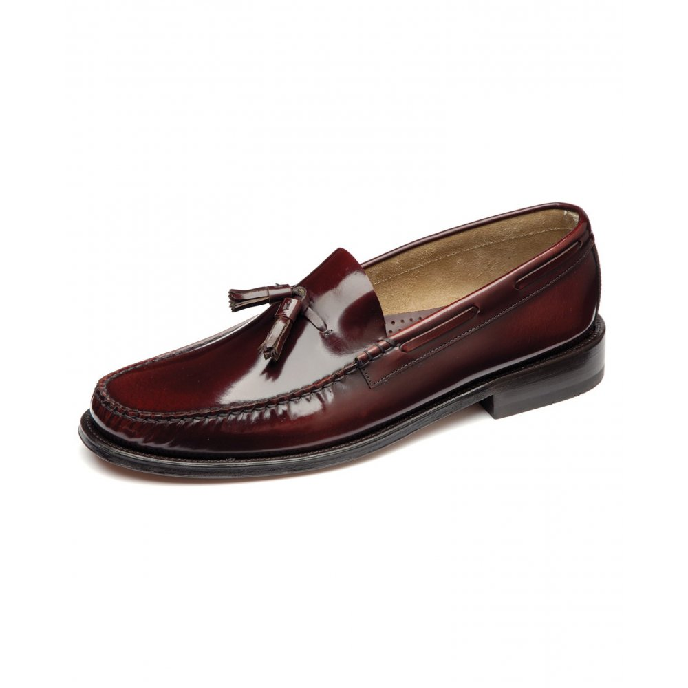 J.M. Weston 's loafers capture renowned Gallic panache with their distinctive profile and ageless elegance. Meticulously handmade in France from select grained-leather, this tan pair is a handsome choice. Team yours with a lightweight knit and slim-fit jeans.